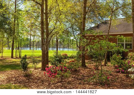 Exterior of residential house in North Florida with nice landscaping and view of lake