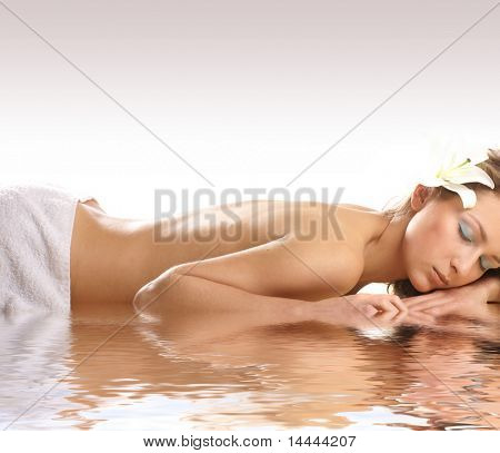 Attractive woman getting spa treatment isolated on white