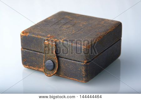 Vintage box upholstered leatherette with button lock.
