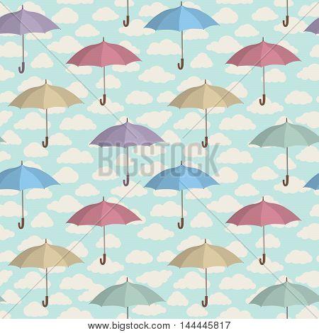 Umbrella seamless pattern. Cloudy sky tiling pattern. Rainy weather ornamental background