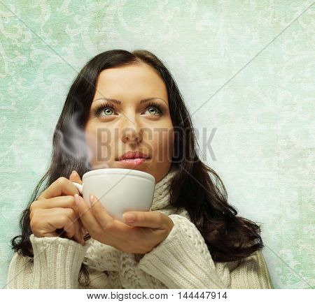 Woman in warm scarf with hot drink