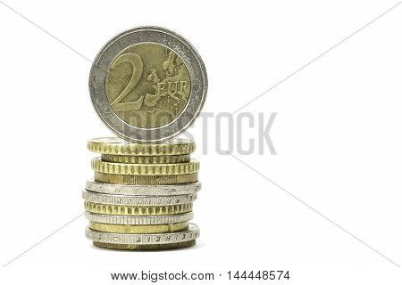 Stack of Euro coins isolated on white background.