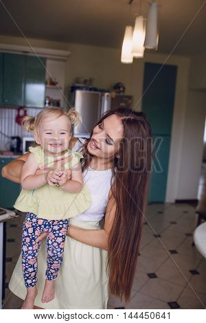 family happy young beautiful mother and little daughter