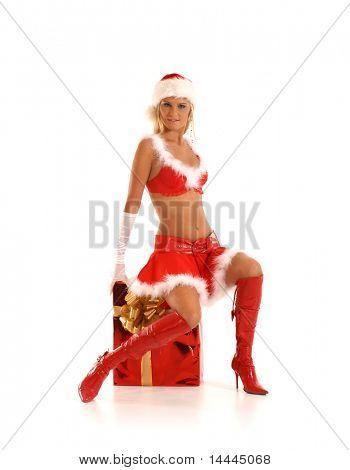 junge sexy Santa sitzen auf ein großes Geschenk isoliert auf weiss
