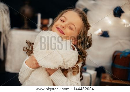 emotionally little girl holds bag. The concept of the New Year and Merry Christmas