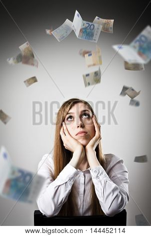 Woman in white and falling Euro banknotes. Currency and lottery concept. Young slim woman.