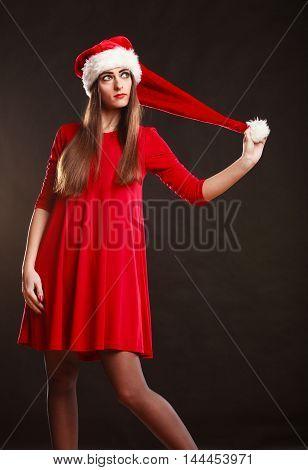 Woman Wearing Santa Claus Hat On Black