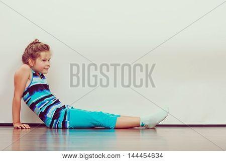 Happy Joyful Little Girl Kid Sitting On Floor.