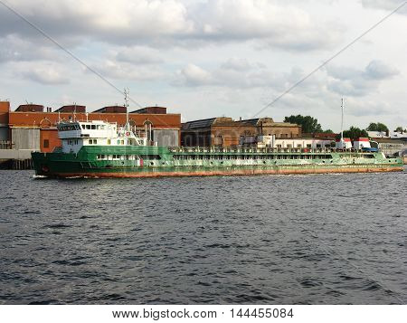 Barge on the Neva river, Saint Petersbutg. Freight water transport. Freight river transport.