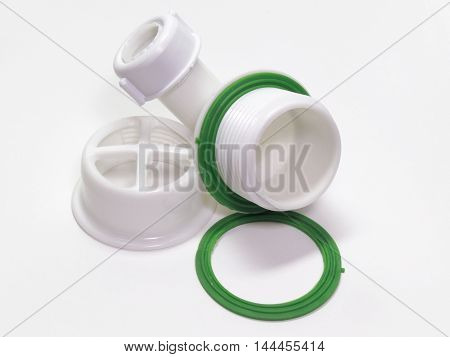 Plastic strainer for drain for hole of the sink. A fragment of the drain system