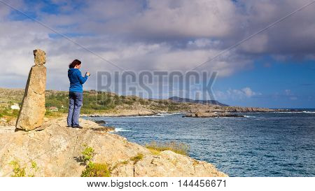 Woman Tourist Taking Photo With Camera In Norway