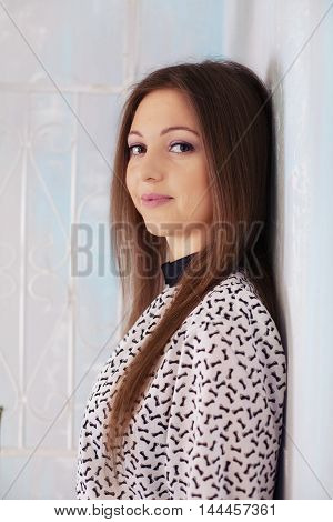 Portrait of a young girl with long hair