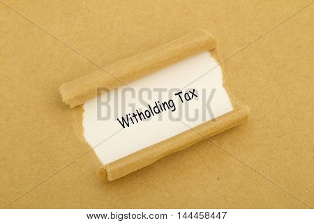 Witholding Tax written under torn paper .