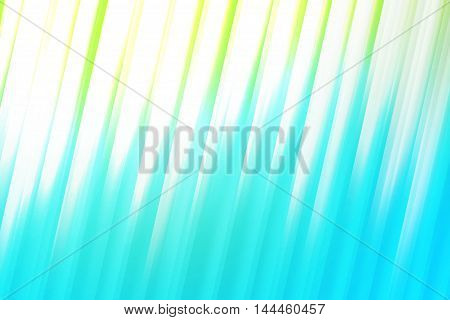 Bue green and white blurred rays of light blend to create abstract background