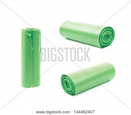 Green plastic polyethylene trash bag roll isolated over the white background, set of three different foreshortenings