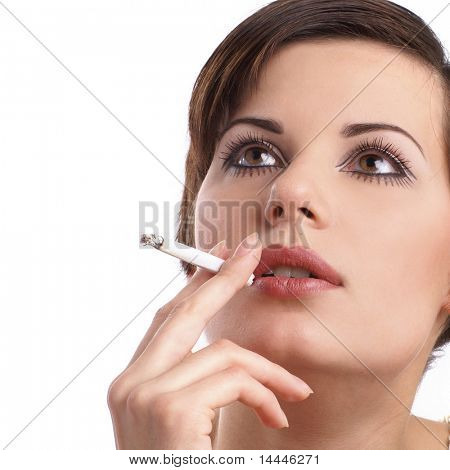 Attractive retro woman smoking over white background
