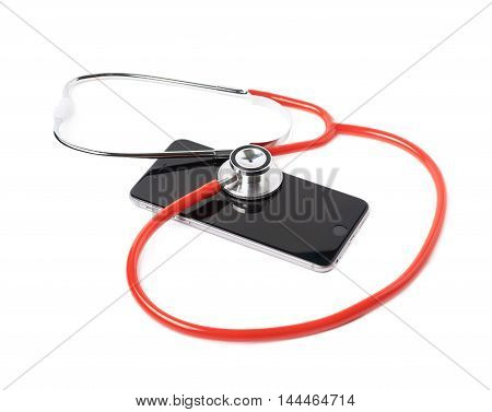 Medical stethoscope tool over the surface of a mobile smart phone, composition isolated over the white background