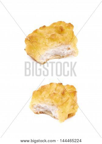 Breaded chicken nugget with a single bite taken of it, composition isolated over the white background, set of two different foreshortenings