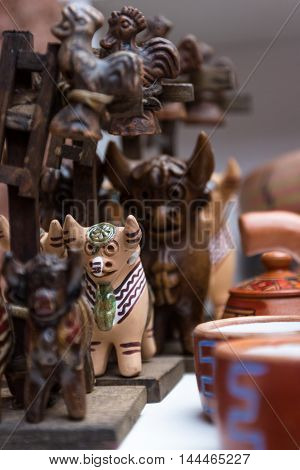 close up of a traditional Peruvian roof ornament with bulls and a cross