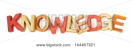 Word Knowledge made of colored with paint wooden letters, composition isolated over the white background