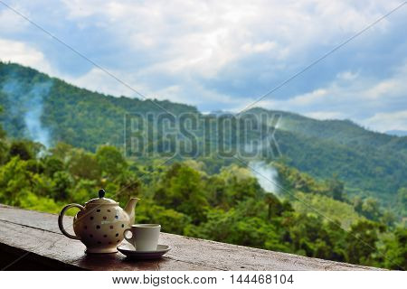 tea cup on wooden and nature background .
