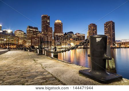 A night shot of Boston City from the harbor