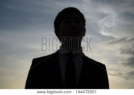 Front Faced Businessman In Silhouette With Sunset Background