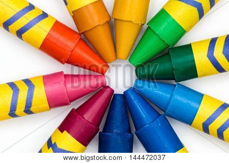 Some color pencils all together forming a circle