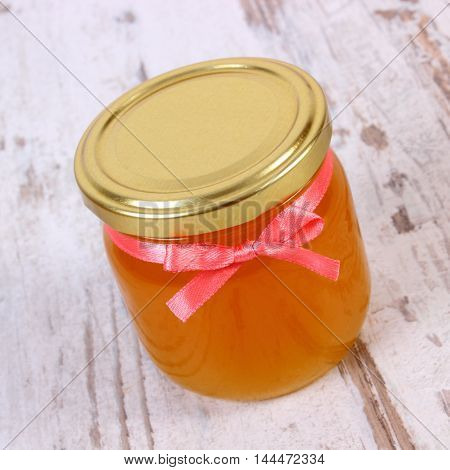 Fresh Organic Honey In Glass Jar On Wooden Background, Healthy Nutrition And Strengthening Immunity