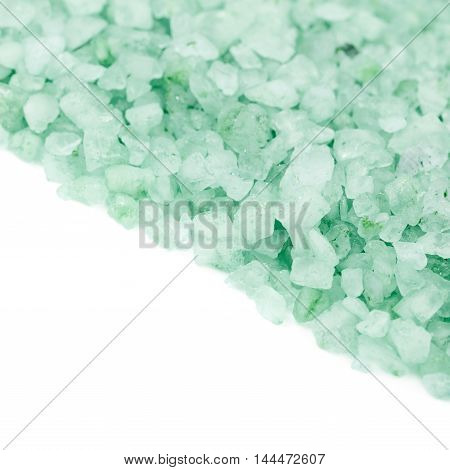 Pile of salt crystals isolated over the white background, close-up crop fragment as a copyspace backdrop composition