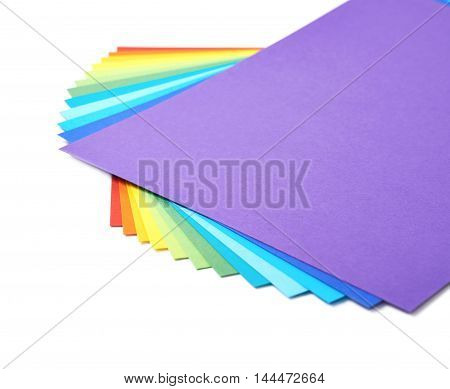 Twisted pile of colorful A4 sheets of paper isolated over the white background, close-up crop fragment as a copyspace backdrop composition