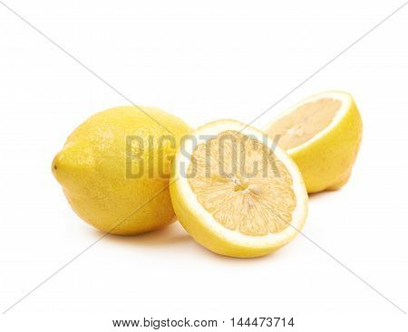Sliced yellow and fresh lemon fruit, composition isolated over the white background