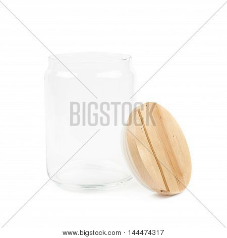 Empty glass kitchen jar with a round wooden cap, composition isolated over the white background