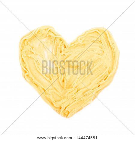 Heart shape made of frosting cream isolated over the white background