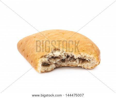 Meat pie with a bite taken of it isolated over the white background