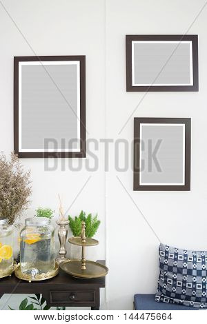 Room interior with frames on white wall stock photo