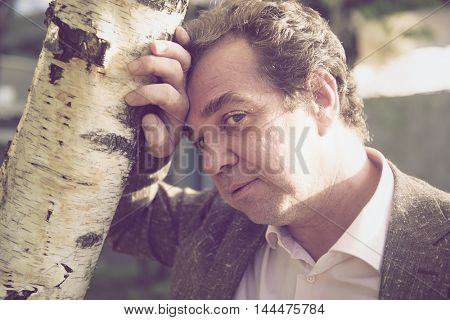 Russian businessman standing at the birch. LOMO effect