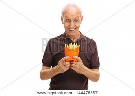 Cheerful senior man looking at a bag of fries isolated on white background