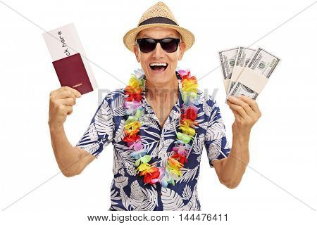 Excited elderly tourist holding stacks of money and a travel voucher isolated on white background