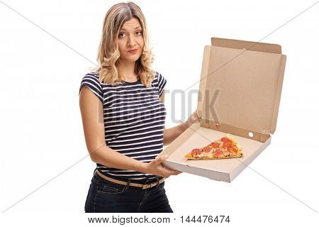 Disappointed woman holding a box with a single slice of pizza isolated on white background