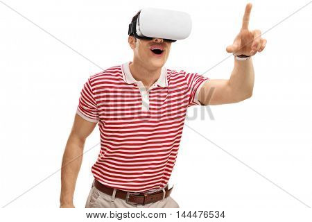 Excited guy experiencing virtual reality and touching something with his finger isolated on white background
