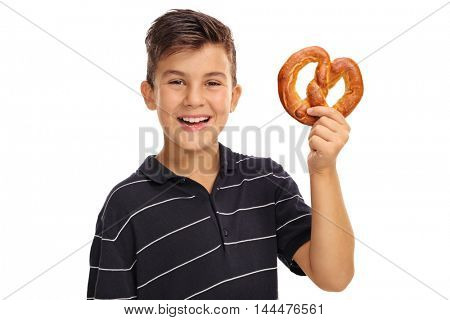 Cheerful boy holding a pretzel isolated on white background