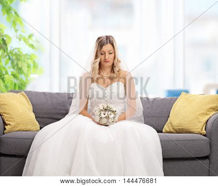 Depressed bride sitting on a sofa