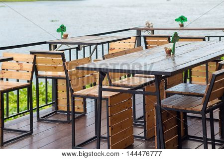 Dining table in the Cozy outdoor cafe beside the river cafe.