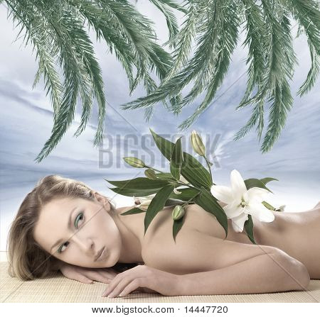 Attractive woman laying on the beach