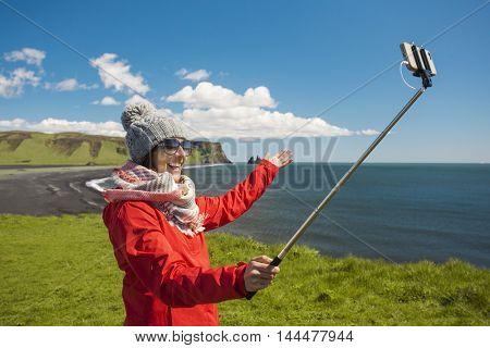 Tourist having fun and making a selfie