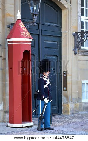 COPENHAGEN DENMARK - AUGUST 15 2016: Danish Royal Life Guard on the central plaza of Amalienborg palace home of the Danish Royal family in Copenhagen Denmark on August 15 2016.
