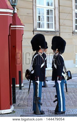 COPENHAGEN DENMARK - AUGUST 15 2016: Danish Royal Life Guards line up for the changing of the guards on the central plaza of Amalienborg palace in Copenhagen Denmark on August 15 2016.