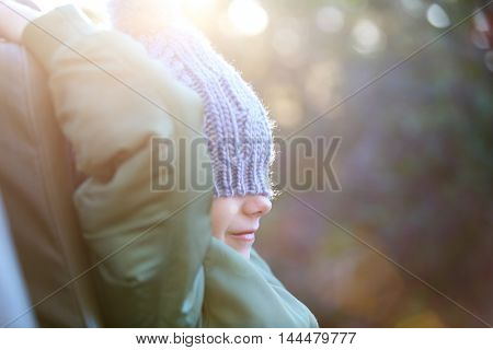 Adorable little girl wearing warm clothes outdoors on beautiful winter morning