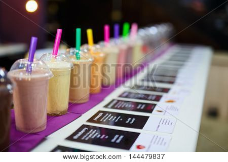 Fresh healthy smoothies with straws for sale